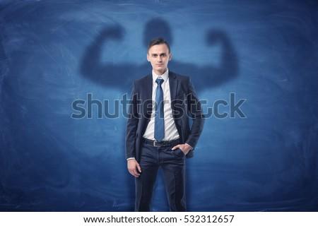 businessman is casting shadow...