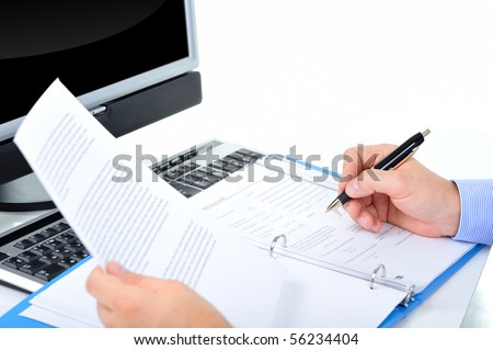 Businessman is checking a paperwork and making notes