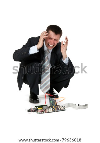 businessman is crying over the broken computer on a white background