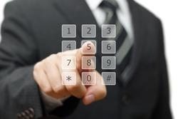 businessman is dialing on virtual telephone keypad