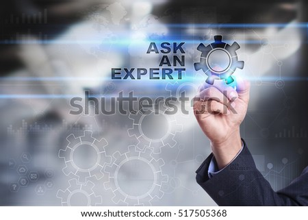 Businessman is drawing on virtual screen. ask an expert concept #517505368