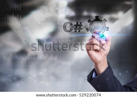 Businessman is drawing on virtual screen. c# concept. #529220074