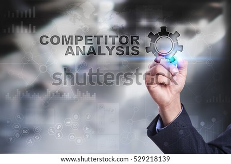 Businessman is drawing on virtual screen. competitor analysis concept.