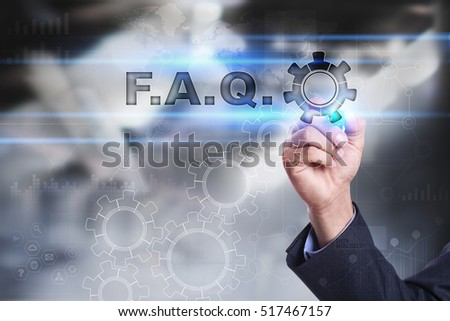 Businessman is drawing on virtual screen. f.a.q. concept #517467157
