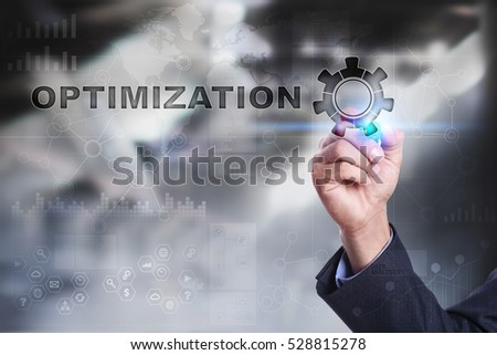 Businessman is drawing on virtual screen. optimization concept.