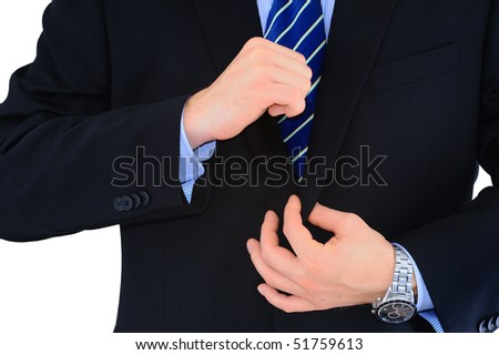 Businessman is fixing his necktie isolated over white
