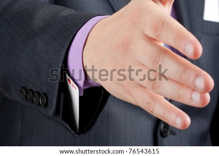 Businessman is going to handshake with ace up in sleeve