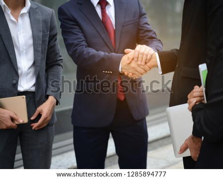 Businessman is handshakes greeting to expressing gratitude and congrats to teamwork successful agreement, Handshakes is a communicating to reassuring tactile touch is essential for social interaction #1285894777