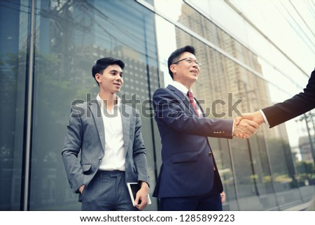Businessman is handshakes greeting to expressing gratitude and congrats to teamwork successful agreement, Handshakes is a communicating to reassuring tactile touch is essential for social interaction #1285899223