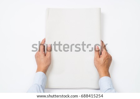 Businessman is holding blank newspapers on isolated background.