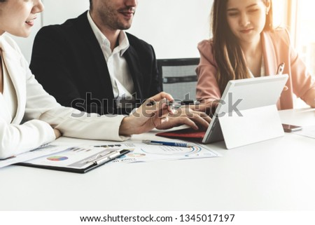 Businessman is in meeting discussion with colleague businesswomen in modern workplace office. People corporate business team concept. #1345017197