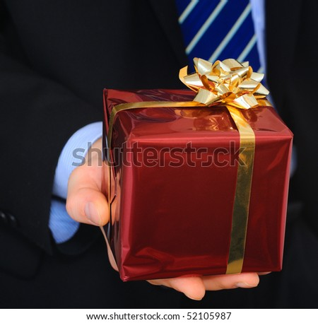 Businessman is making a gift