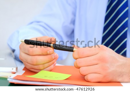 Businessman is negotiating terms of contract