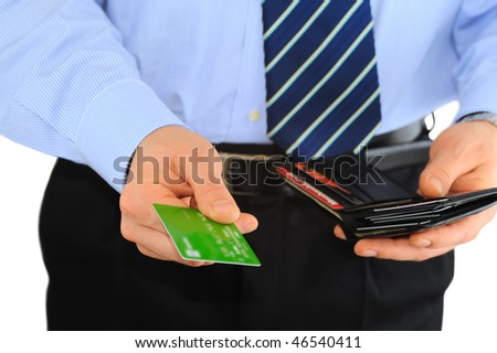 Businessman is paying with credit card isolated on white