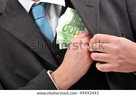 Businessman is putting euros banknotes money in pocket of his suite, financial corruption background