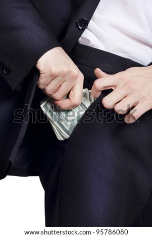 Businessman is putting money in his pocket