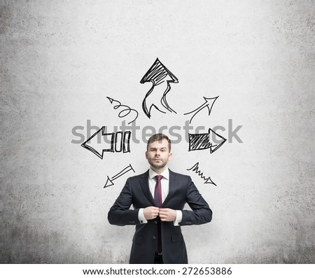 businessman is standing surrounded by arrows in different direction. A concept of decision making process.