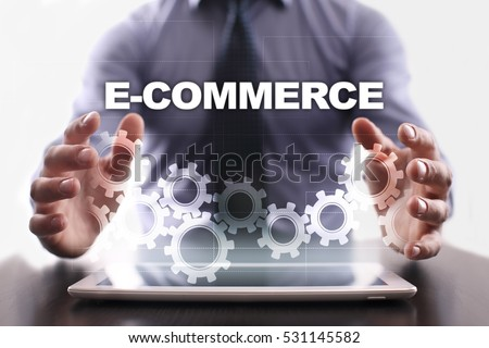 Businessman is using tablet pc and selecting e-commerce.