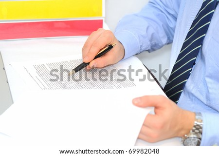 Businessman is verifying a contract