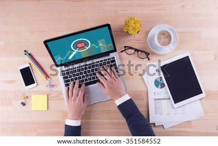 Businessman is working on desk -  SEO