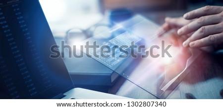 Businessman is working on financial strategy using modern hi tech digital tablet #1302807340
