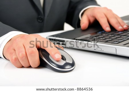 businessman is working or operating computer and mouse