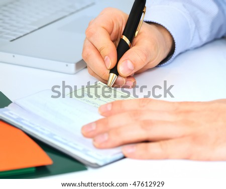 Businessman is writing a check