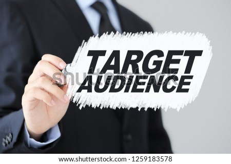 Businessman is writing with marker. Target Audience Business concept.
