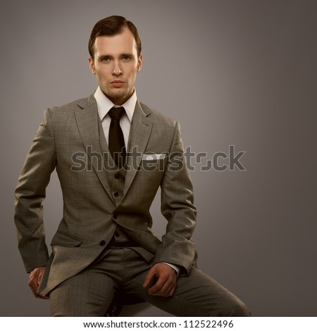 businessman isolated on grey...