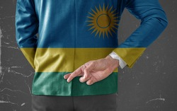 Businessman Jacket with Flag of Rwanda with his fingers crossed behind his back