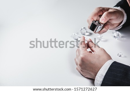 Businessman jeweler during the evaluation of jewels with magnifier. Jeweler looking at diamonds or Luxury stone through loupe evaluating gem a symbol of business success or successful finance concept