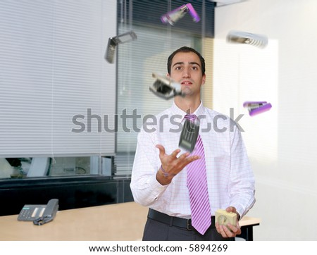 Businessman juggling in an office. Relief from stressful office life.