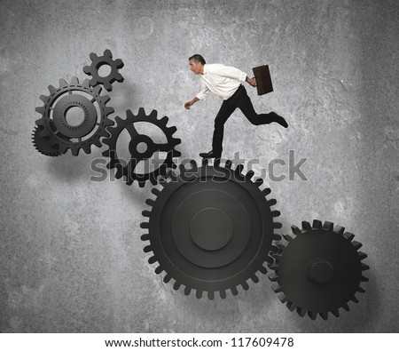 Businessman jump on gear system