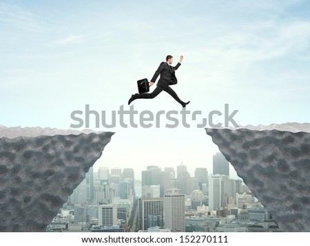 businessman jumping from rock to another rock