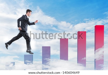 Businessman jumping on a growth graphic