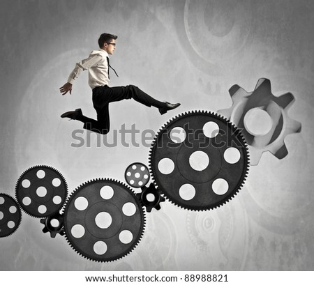 Businessman jumping on some mechanisms