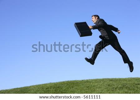 Businessman jumping outdoors