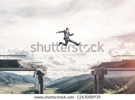 Businessman jumping over huge gap in concrete bridge as symbol of overcoming challenges. Skyscape and nature view on background. 3D rendering. #1263088939