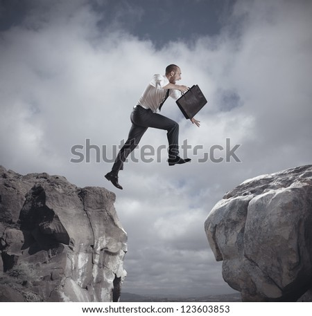 Businessman jumping over the mountains. concept of ambition in business