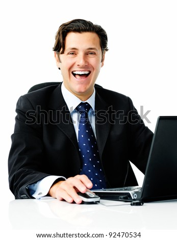 Businessman laughs from his desk when he hears that he sealed the best deal of his life