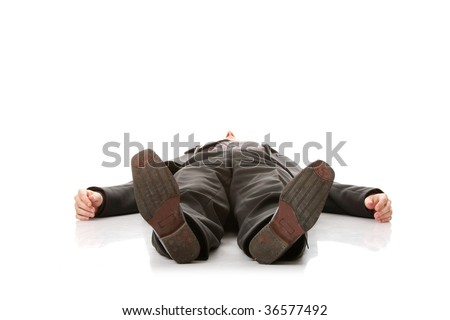 Businessman laying down in a suit isolated on white background