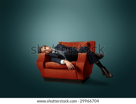 businessman laying on an armchair