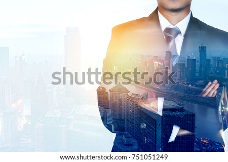 Businessman Leader With Arms Crossed. Double exposure
