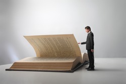 Businessman leafing through a book