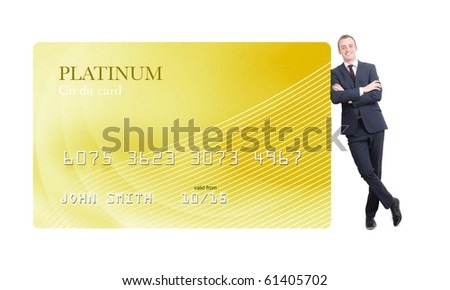 Businessman leaning on credit card - stock photo