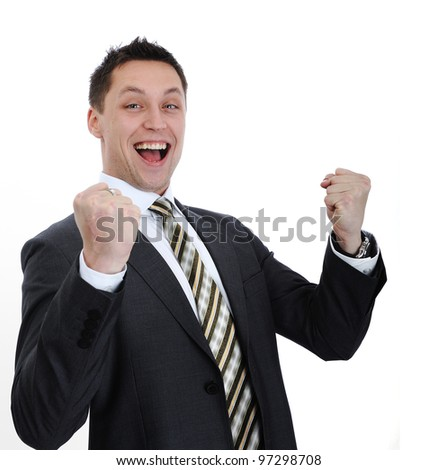 Businessman lifting arms in excitement
