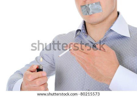 Businessman lights a cigarette. Isolated on white background
