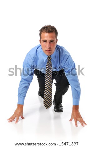 Businessman lined up ready for race in business isolated on a white background