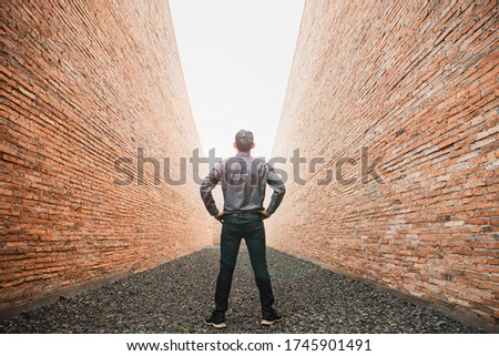 Businessman look at brick wall. Businessman trying to escape from difficult situation. Business people stopped by a brick wall. Business with Dead End. Stalemate. Problem. Сток-фото ©