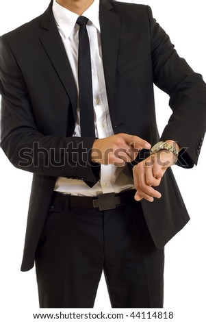 businessman looking and pointing at his watch